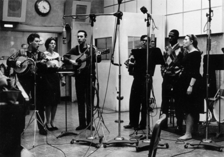 About this photograph, Jean Ritchie said, 'We were asked to get together a record of folk songs for a 'supermarket' album, with no names mentioned, at one point in our early married life. This group was recording for the album *Hootenanny at the Limelight*. The singers-without-names are (left to right) Eric Weisberg, Judy Collins, Marshall Brickman, Mike Settle, Clarence Cooper and Jean Ritchie.' Photograph by George Pickow, courtesy Jean Ritchie and George Pickow