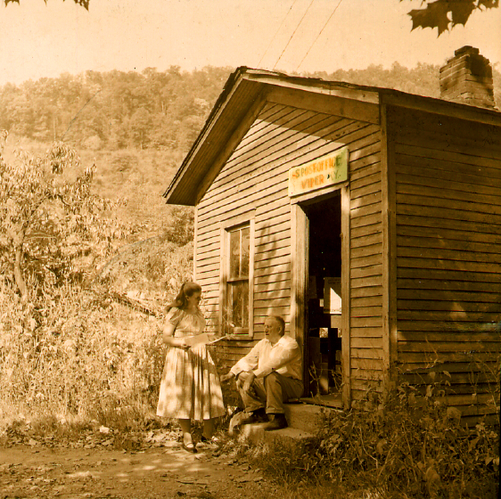 About this photograph, Jean Ritchie said, 'Getting the Ritchie mail at the Viper post office and talking with our postmaster, Marion Brashears, Viper, Kentucky.' Photograph by George Pickow, courtesy Jean Ritchie and George Pickow