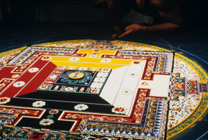 Losang Samten at work on 'Wisdom,' colored sand, 5' in circumference, University of Pennsylvania Museum, 1989, courtesy Losang Samten