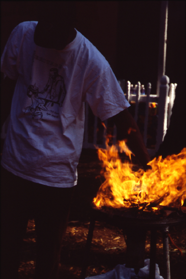 Heating iron in fire, Fall Folklife Festival, 2000, photograph by Vennie Deas-Moore, courtesy Folklife Resource Center, McKissick Museum, University of South Carolina, Columbia, South Carolina
