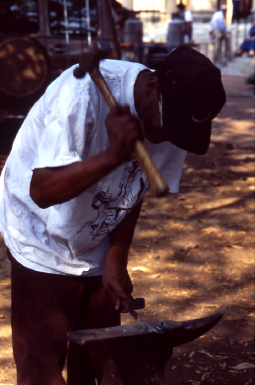 Hammering a piece of iron on an anvil, Fall Folklife Festival, 2000, photograph by Vennie Deas-Moore, courtesy Folklife Resource Center, McKissick Museum, University of South Carolina, Columbia, South Carolina