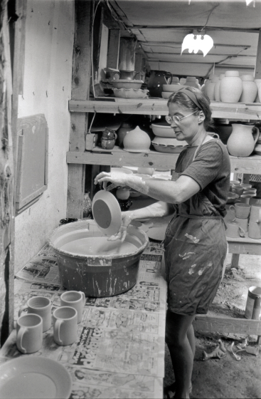 Nancy Sweezy glazing pots at Jugtown, North Carolina, courtesy Nancy Sweezy