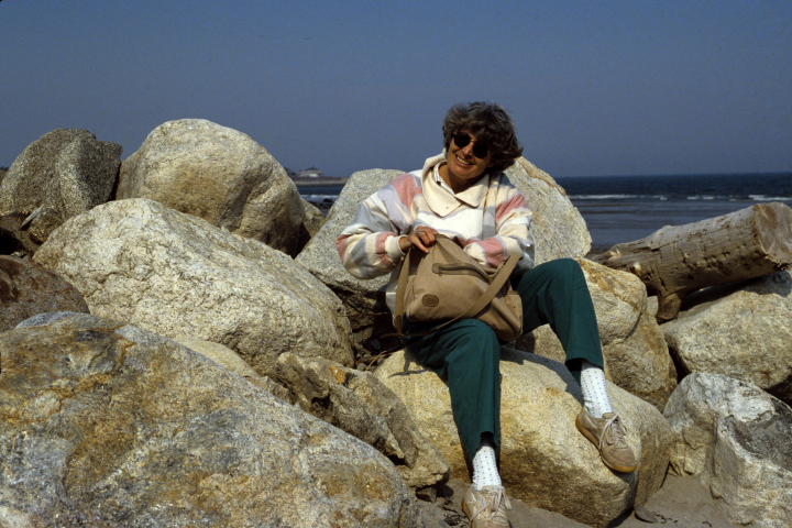 Nancy Sweezy sitting on rocks outside grandfather's house in Rye, New Hampshire, ca. mid-1980s, courtesy Nancy Sweezy