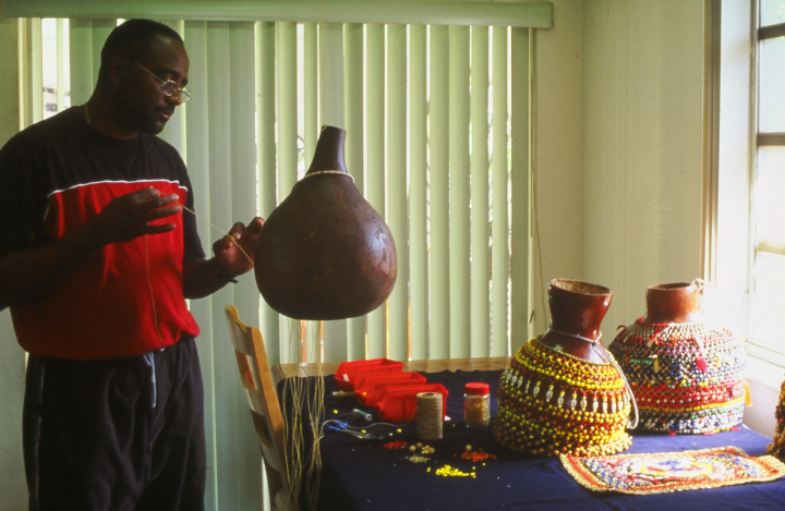 Ezequiel Torres making *shekeres* (gourd rattles), courtesy National Endowment for the Arts